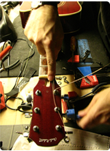 Guitar Technician Steve Mindick Restringing Guitar