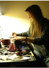 Guitar Technician Steve working on Acoustic Guitar